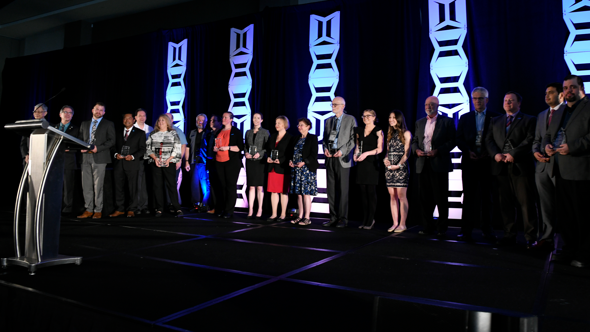 The 2018 AAMI Award winners stand on stage during the AAMI Exchange