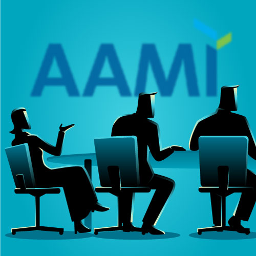 silhouetted professionals sit around a table in front of the AAMI logo.