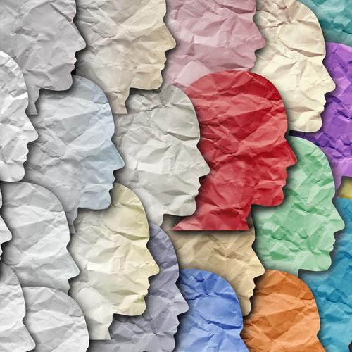 Paper faces become increasingly colorful to represent diversity.