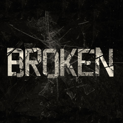 """The word """"broken"""" surrounded by shattered glass"""