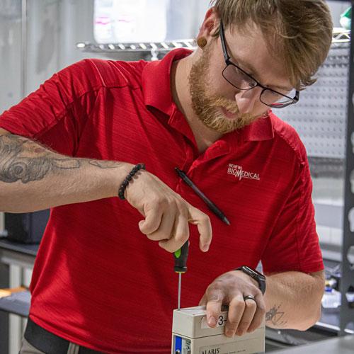 BMET Apprentice Caleb Barber repairs a medical device