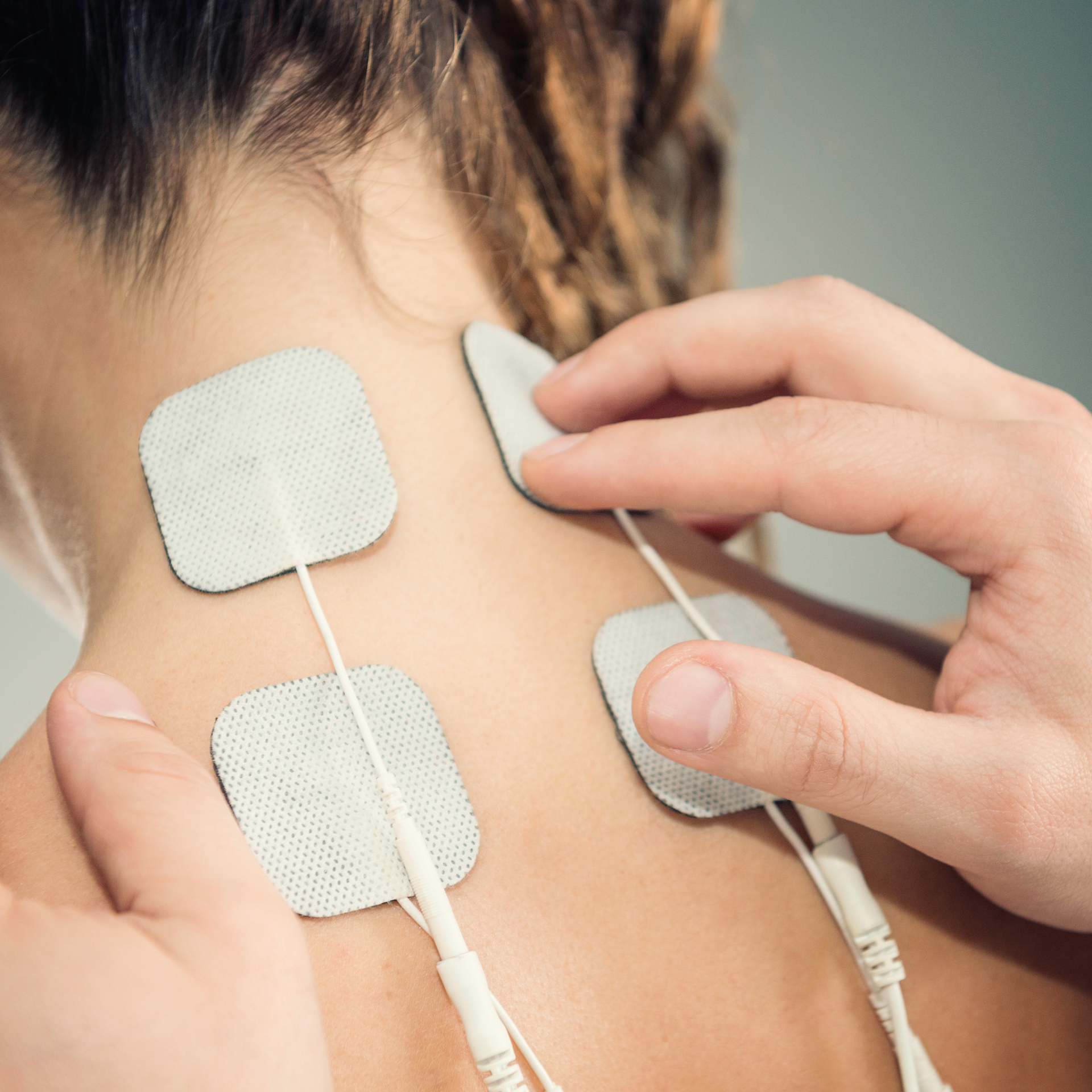 Electrodes are placed onto the back of a patient's neck.