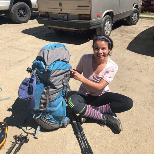 Fernanda Zamudio poses while backpacking.