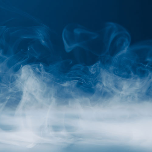 Wisps of gas rise from a surface.