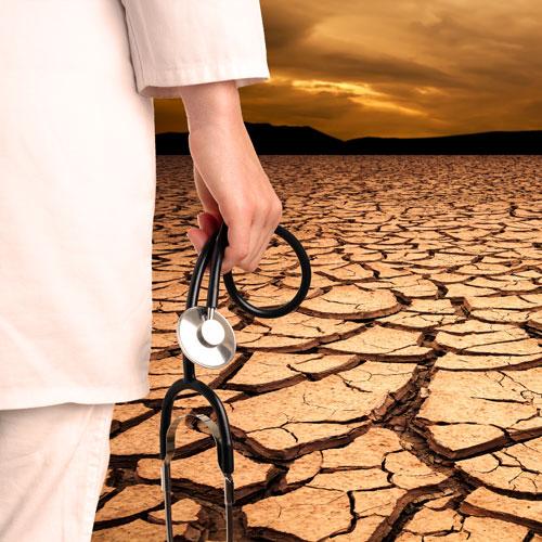 A physician stands before an empty desert