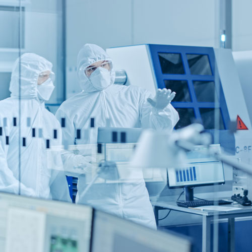 Sterilization professionals in full PPE.
