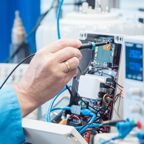 A technician preforms equipment maintenance.