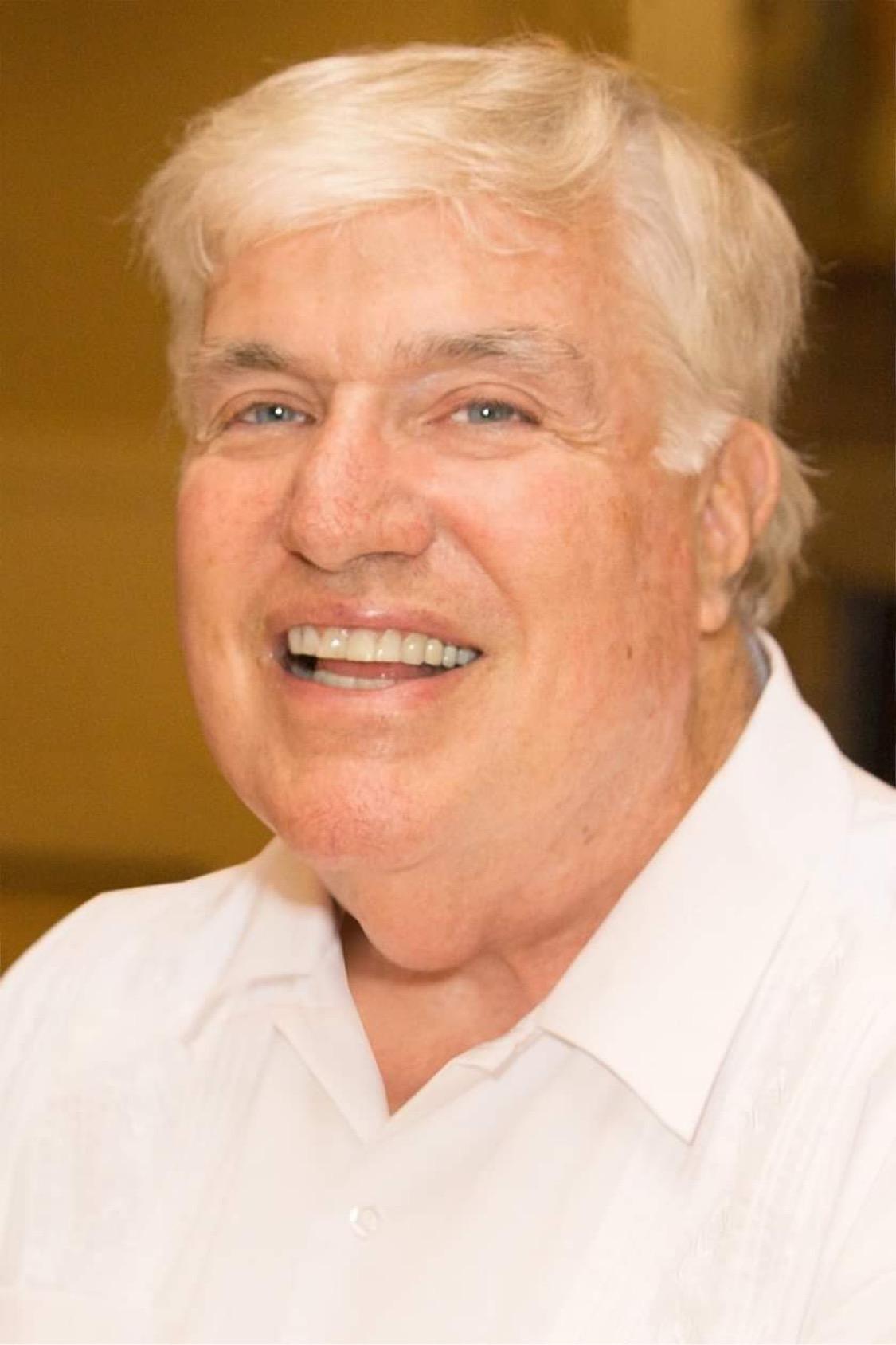 Portrait of a grinning Tom O'Dea.