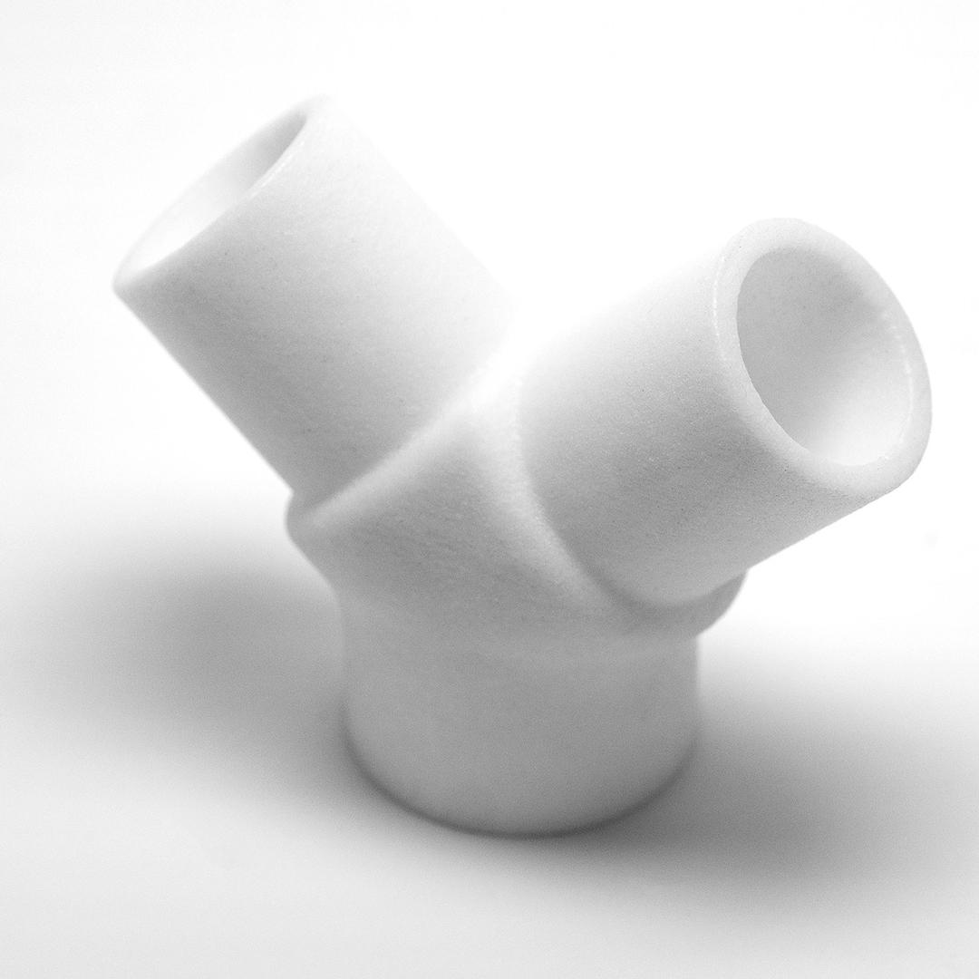 A white, Y-shaped ventilator expansion splitter.